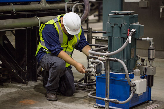 Plant Operator Performing Suggested Centrifuge Maintenance
